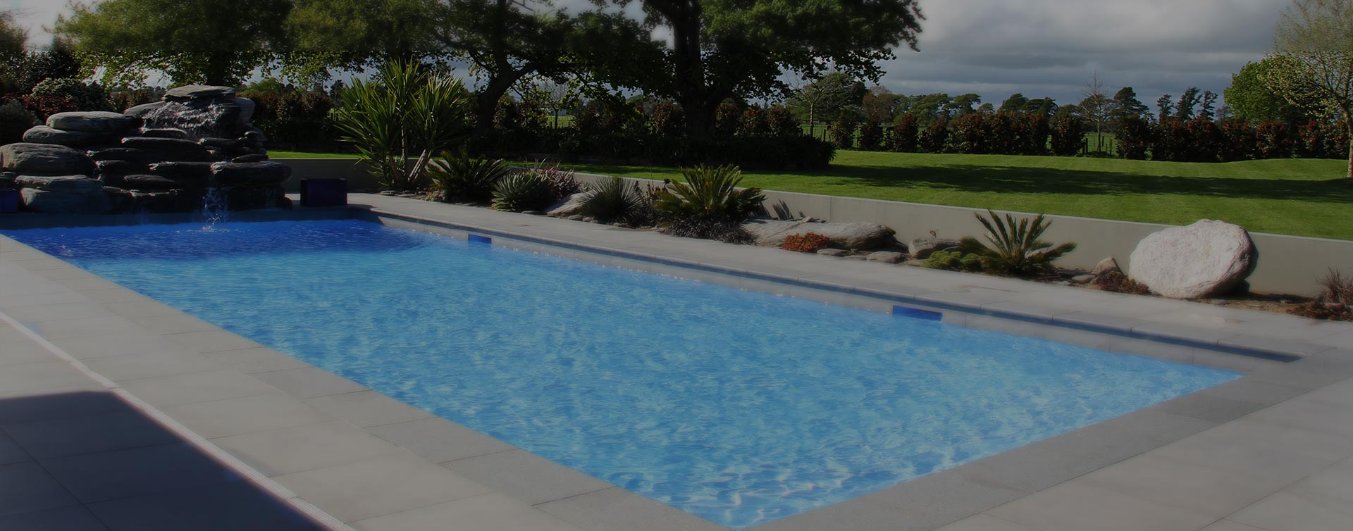 Hamilton pool installation in ground pools and landscaping for Above ground swimming pools nz